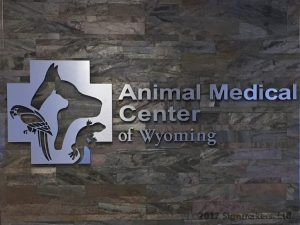 Animal Medical Center of Wyoming silver letters with animal sign