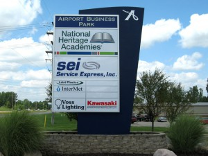 large sign with multiple tenants