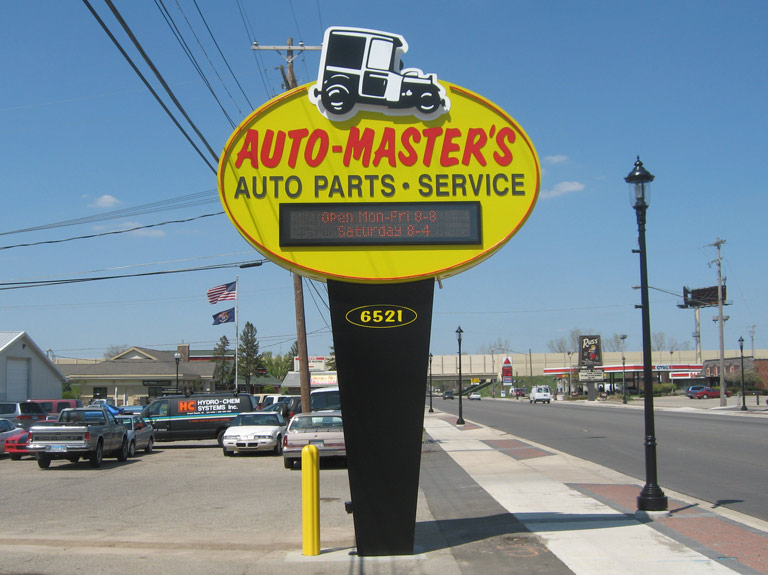 Auto-masters pylon sign on the side of the road