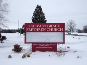 Calvary Grace Brethren Church sign in snowy yard