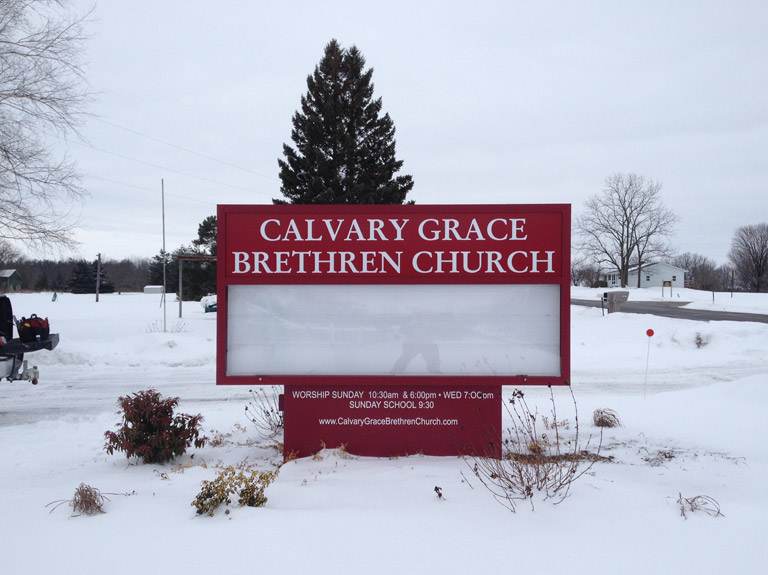 Calvary Grace Brethren Church sign in snowy yard