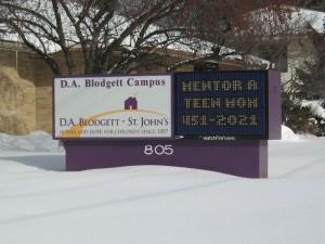 DA Blodgett sign with digital display in snowy yard