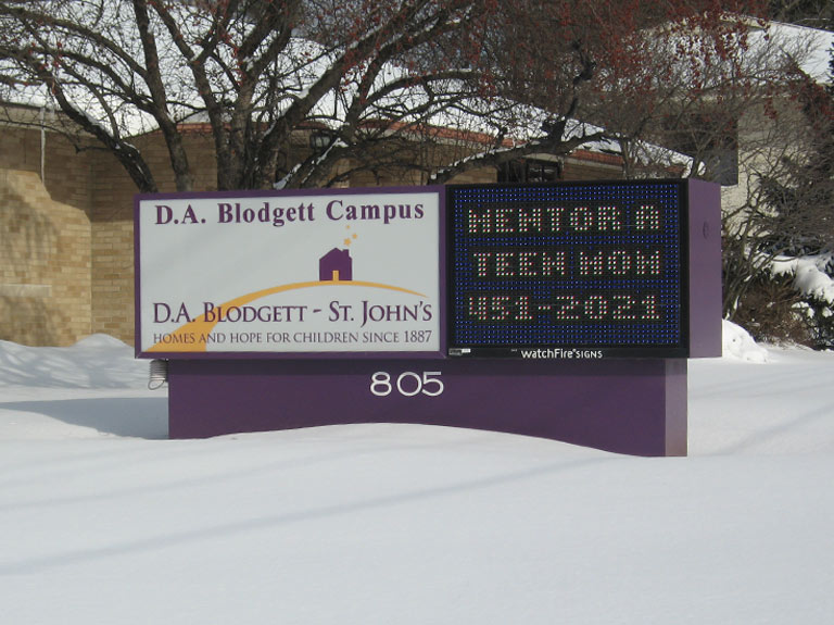 DA Blodgett sign with digital display in snowy yard