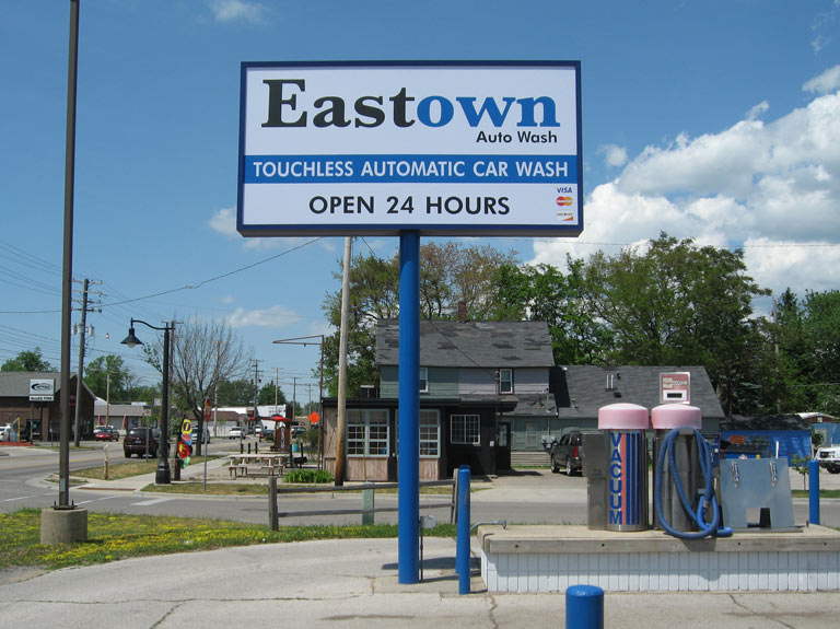 Eastown Auto Wash box sign on pole in parking lot