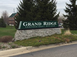 Grand Ridge Professional Offices sign on brick base in yard