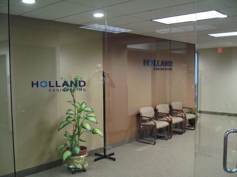 3D letters and vinyl lettering on interior wall and glass