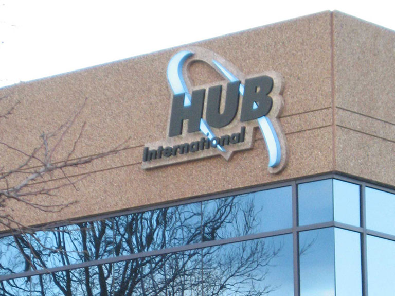 Hub International sign on the side of a building