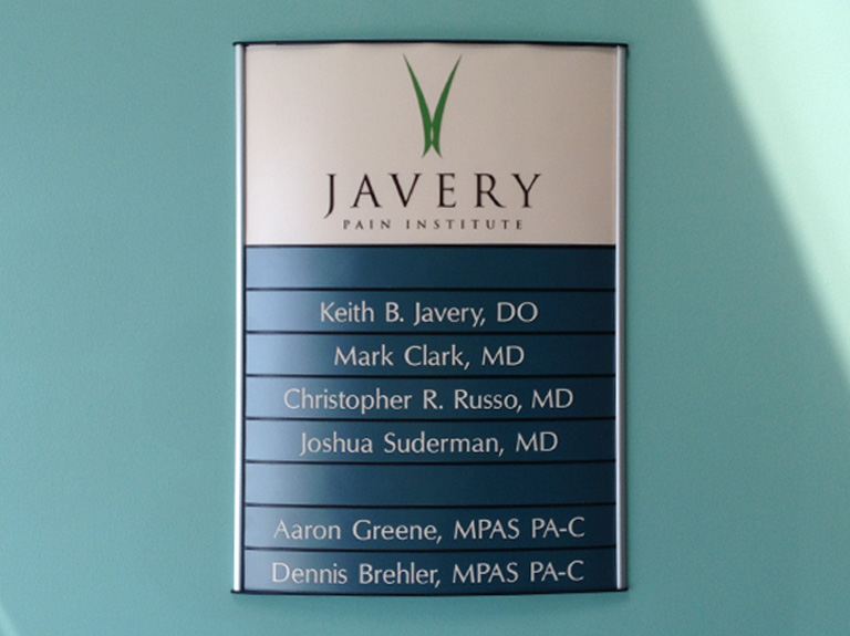 interior directional sign on wall