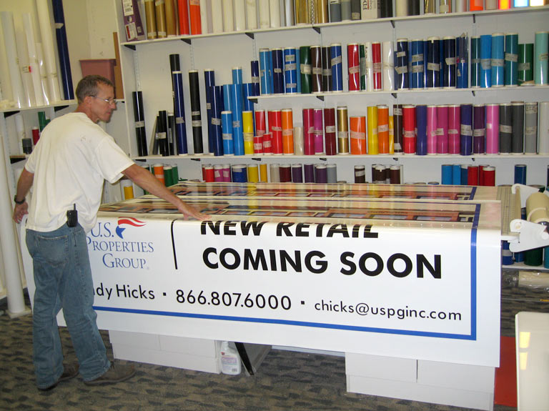 art room with rolls of vinyl and a large print