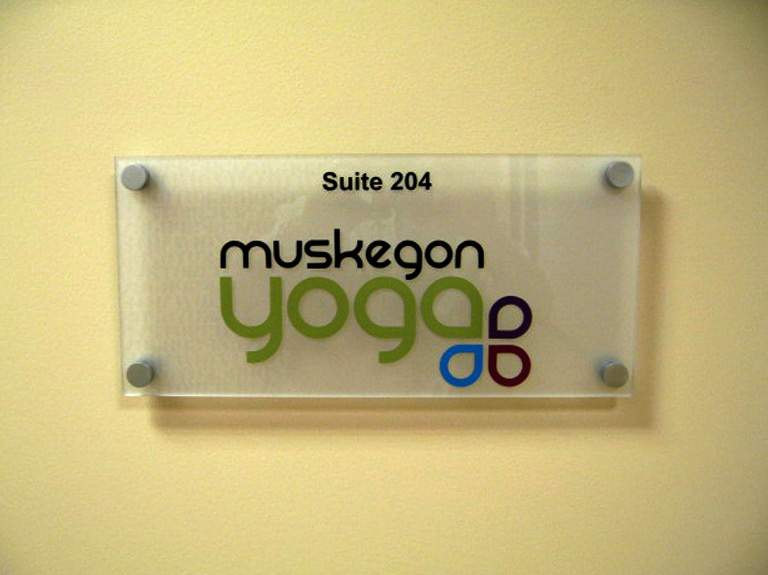 Muskegon yoga interior way finding sign on wall