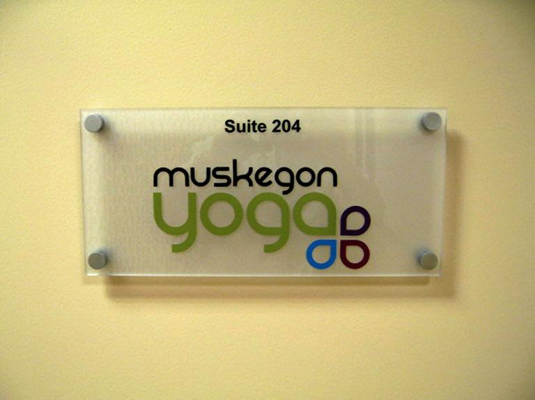 Muskegon yoga interior way finding sign on wall