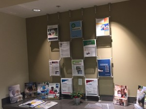 special racks mounted to ceiling and table top displaying brochures