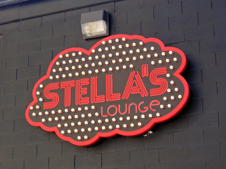 Stella's Lounge wall sign by day