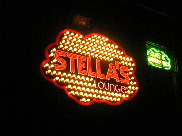 Stella's Lounge wall sign by night