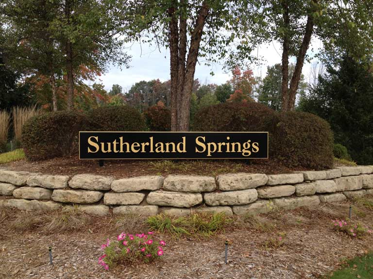 Sutherland Springs sign on wall