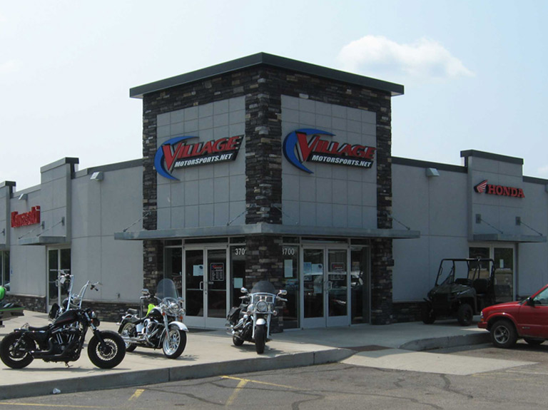 the front of the building at village motor sports