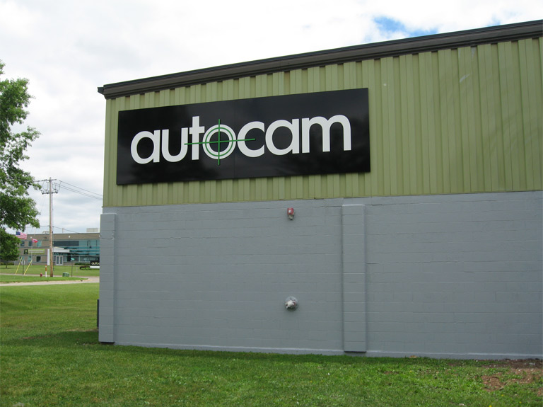 Autocam wall letters on the side of a building