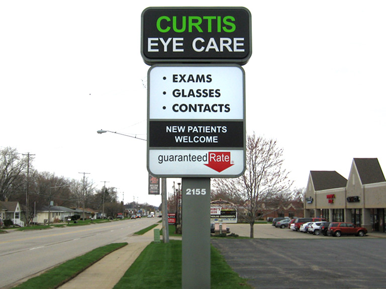 Curtis Eye Care pylon sign in front of building