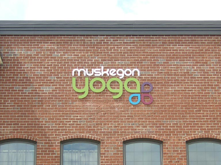Muskegon Yoga letters on brick wall