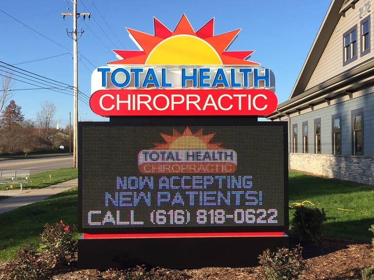 Total Health Chiropractic center monument sign with digital display and channel letters