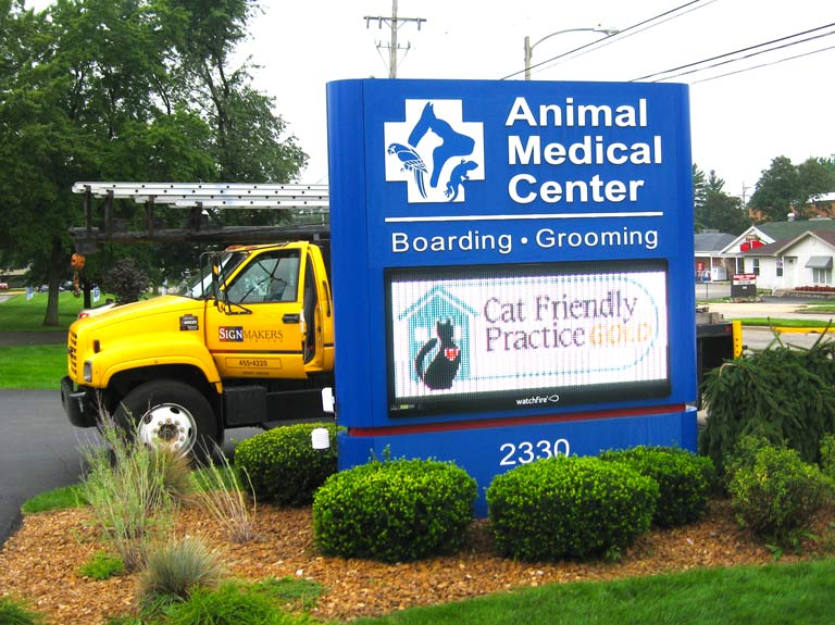 animal medical center sign with signmakers, ltd. truck
