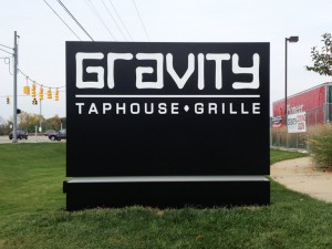 gravity taffies and grille yard sign