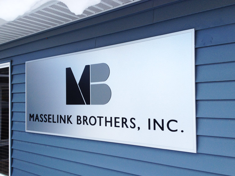 Masse link Brothers silver sign on wall