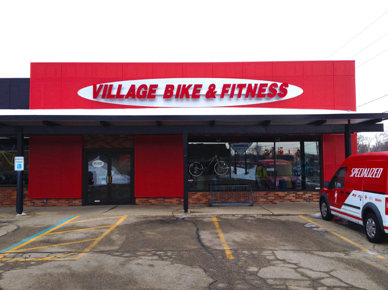 Village Bike and fitness red letters on wall