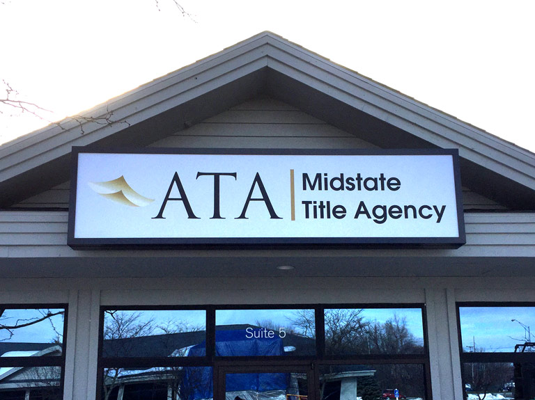 Sign on front of building in peak for ATA Midstate Title