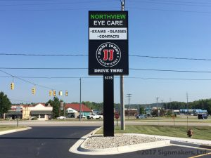 A large pole sign with businesses Northview Eye Care and Jimmy Johns Sandwiches.